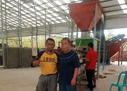 Engineer with workers at Timor Leste project site for installation
